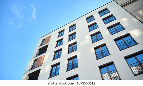 Fragment of modern luxury residential apartment,  home house building concept. Modern apartment building on a sunny day with a blue sky.