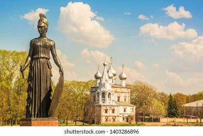 Fragment of  monument to  Russian poet Konstantin Batyushkov and  ancient church of St. John Chrysostom in Vologda. Russia, Vologda. May 10, 2019