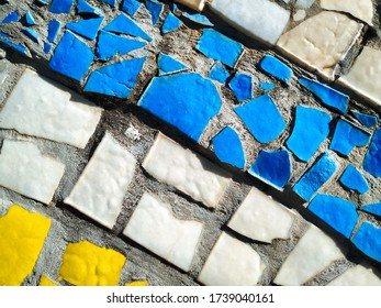 Fragment of mosaic porcelain ceramic tile background. Colored rectangles. Abstract architectural pattern and design elements. Colorful wall.