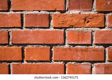 Fragment of new smooth red brick wall. Abstract texture background