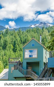 Fragment of a nice house over fantastic snow mountain view in Whistler, Vancouver, Canada.