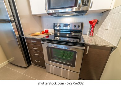 Fragment of the nicely decorated small luxury kitchen with modern appliances. Interior design.