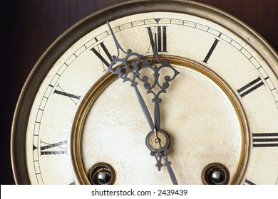 fragment of old antique clock on dark background