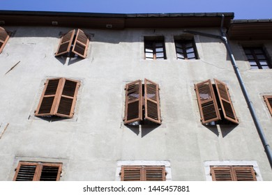 Fragment of an old building against the blue sky.Closeup.Chambery.France.