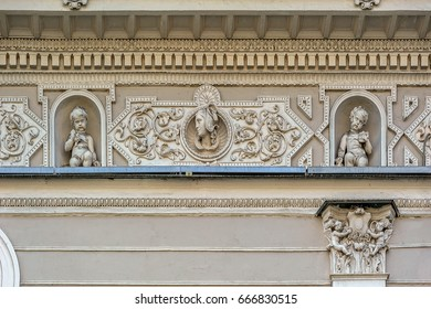 Fragment of an old building facade with ornate decoration in the center of St. Petersburg at sunny day, Russia.