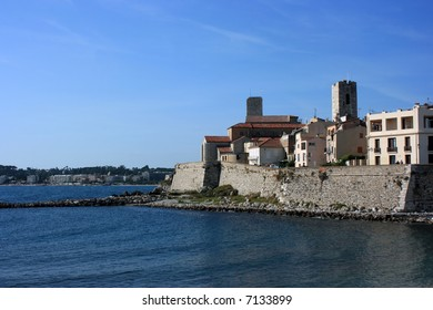 A fragment of an old fortified part of French city Antibes at day