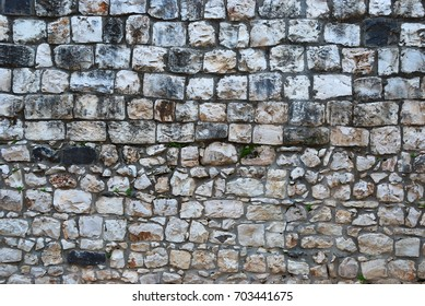 Fragment of old grunge stone wall