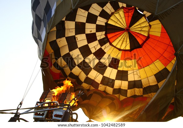 A fragment of an old hot air balloon during the start of the flight. The burner with the fire. Hot air balloon competitions.