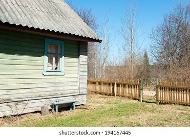 Fragment of old rural house and fence in Novgorod oblast
