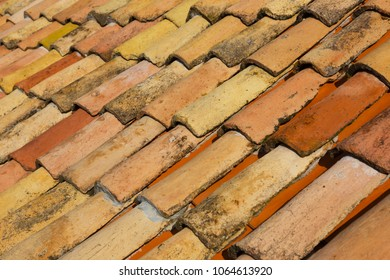 Fragment of an old tiled roof close up