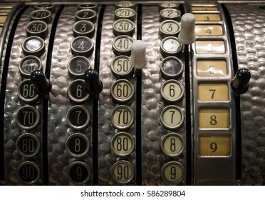 The fragment of old and vintage adding machine.