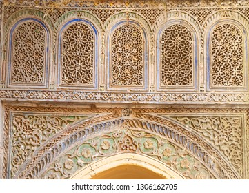 Fragment of an old wall decorated with stone carvings in Morocco
