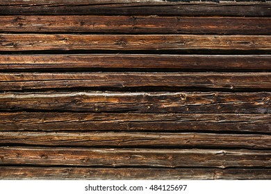 Fragment of old wooded wall from logs, background