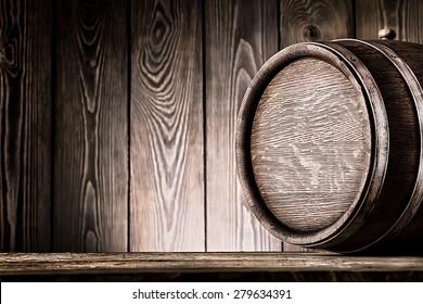 Fragment of old wooden barrels on planks background
