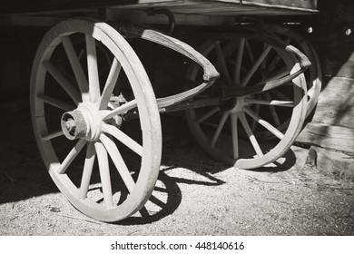 Fragment of an old wooden cart, black and white photo