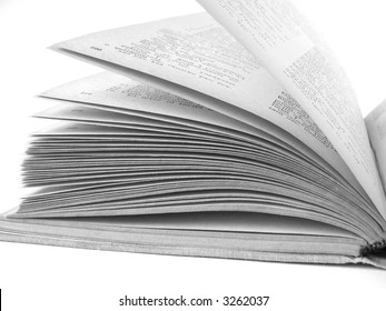 fragment of the opened book at the white background