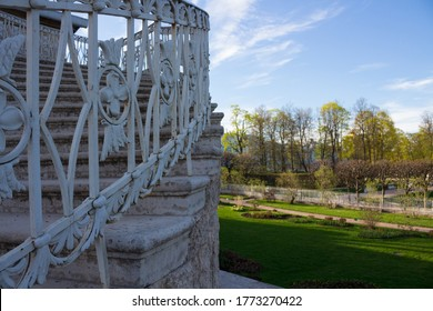 A fragment of an openwork staircase leading to the gallery of the Catherine Park and a view of the Park itself. There are no people.