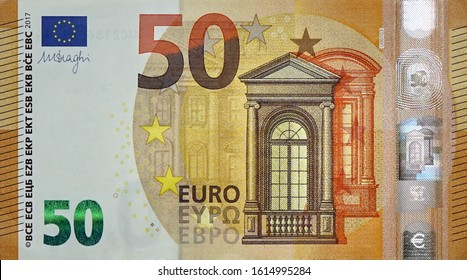 Fragment part of 50 euro banknote close-up with small brown details