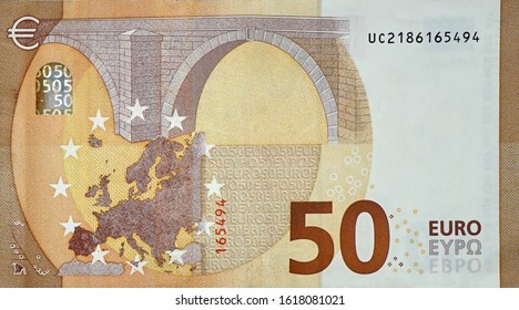Fragment part of 50 euro banknote close-up with small brown details. European currency bill