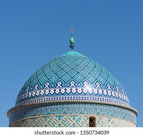 Fragment photo of mosque in Iran,beautiful Persia.Architectural fragment of Jameh Mosque (Friday Mosque), an exquisite 14th cen building with rich Islamic patterns of azure tile, brickwork and pattern