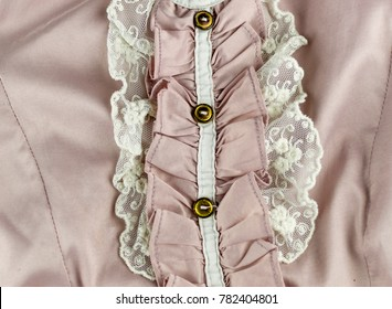a fragment of a pink blouse with ruffles