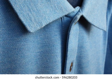 Fragment of pure cotton polo with button close up.