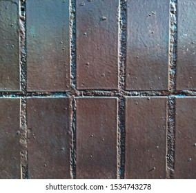 fragment of a real old wall with ceramic tiles glued with peeling paint. close-up.abstract vintage background for your design.