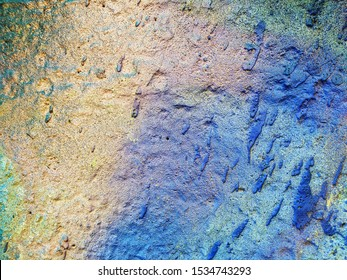 fragment of a real wall painted with different colors.abstract background for your design.close-up
