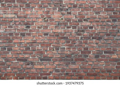 Fragment of a red brick wall. Background image.