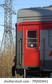 A fragment of a red car, a train. Door