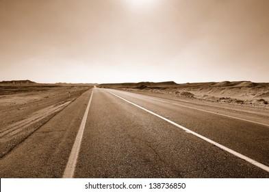 Fragment of road in the desert. Sepia