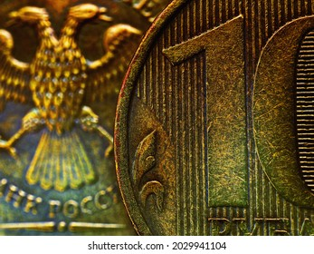 A fragment of a Russian coin in 10 ten rubles close up. Dark impressive illustration. Economy, finance and banks of Russia. Scratched coins from circulation. Macro - Shutterstock ID 2029941104