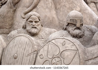 Fragment of sculpture from sand on the theme of mythology. Odin is the supreme god in German-Scandinavian mythology. God of war and victory, wind and navigation