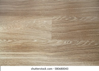 Fragment of seamless wooden oak panel laminate parquet floor texture background.