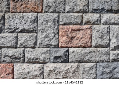 Fragment of a stone wall in a background photo.