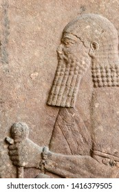 fragment of stone wall relief from ancient Assyria