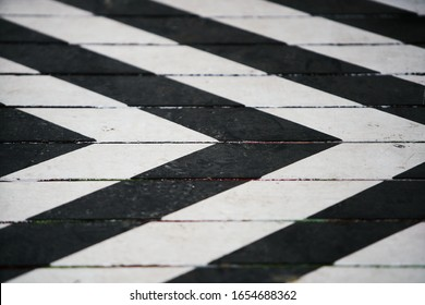 Fragment of a striped wrinkled black and white piece of a cloth fabric as a background texture - Shutterstock ID 1654688362