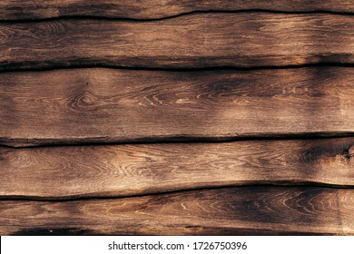 A fragment of a strong wooden fence. Horizontal boards are tightly nailed to each other and provide reliable protection from robbers. Symbol of safety.
