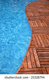 Fragment of a swimming pool and wooden floor