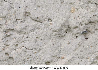 Fragment of uneven concrete surface. This image can be used as background.