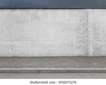 a fragment of an urban concrete wall of a building and an asphalt sidewalk, a building facade, a template or source