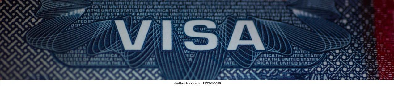 Fragment of USA visa Head (cap) in Passport. Close up, macro wide shot.