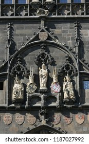 Fragment of the wall and details of the sculpture and symbols on the tower on Charles Bridge in Prague