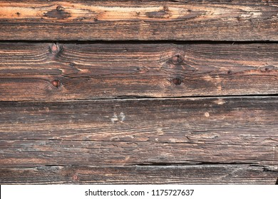 Fragment of the wall of economic construction of the beginning of the last century. Softwood boards.