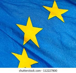 Fragment of the waving European Union Flag in sunshine