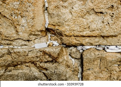 Fragment of Western Wall with sticky notes in Jerusalem Israel