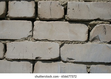 Fragment of white brick wall