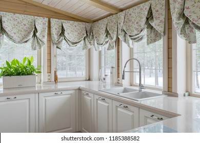 Fragment of white kitchen with many windows