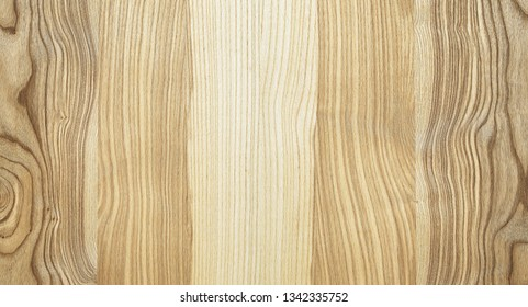 A fragment of a wooden panel hardwood. Ash.