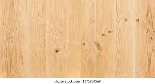 A fragment of a wooden panel hardwood. Pear tree.
